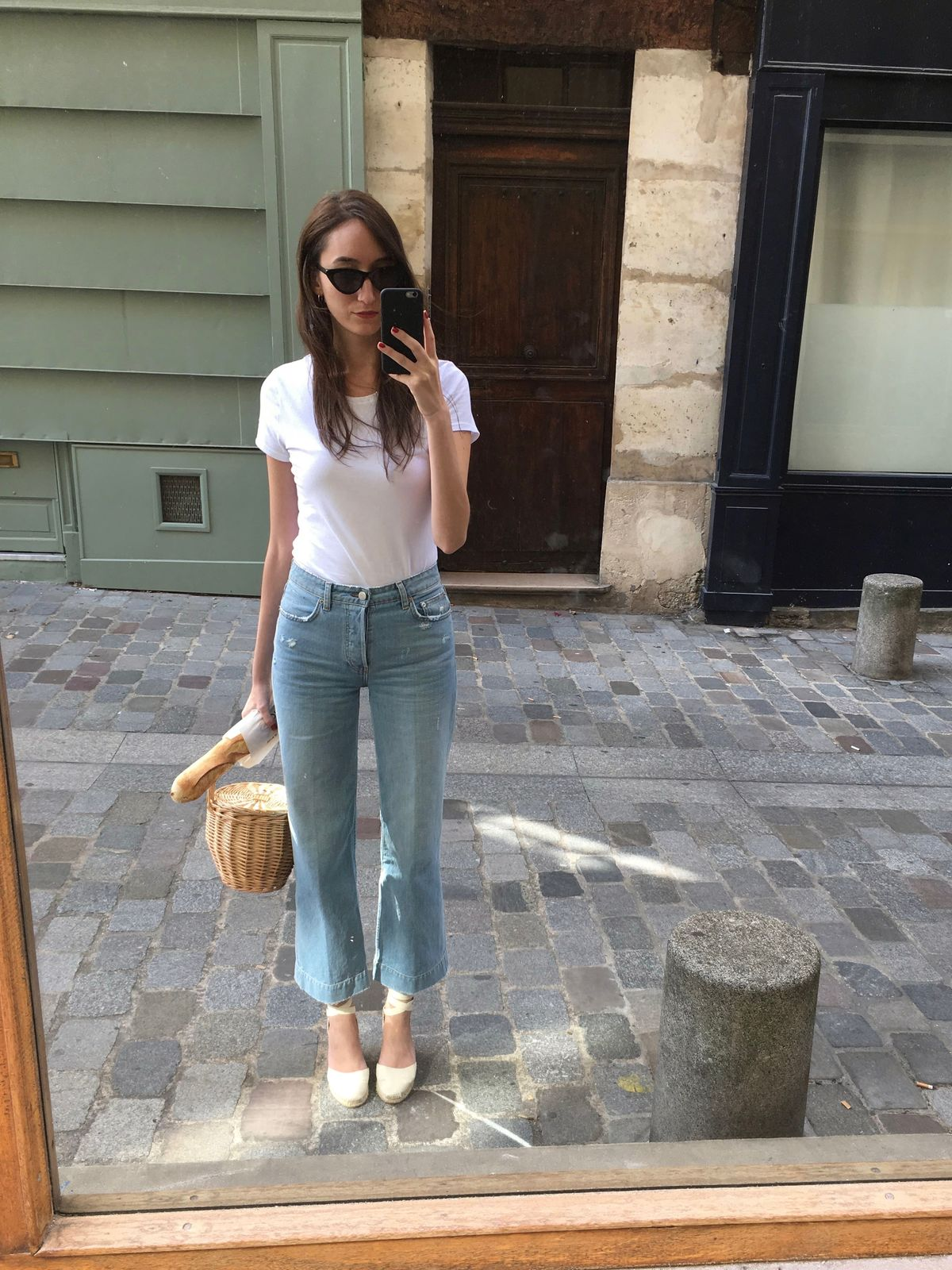 French Girl Accessories - basic white t-shirt, wide leg jeans, Birkin basket bag, Castaner espadrilles, black cat-eye sunglasses and a baguette