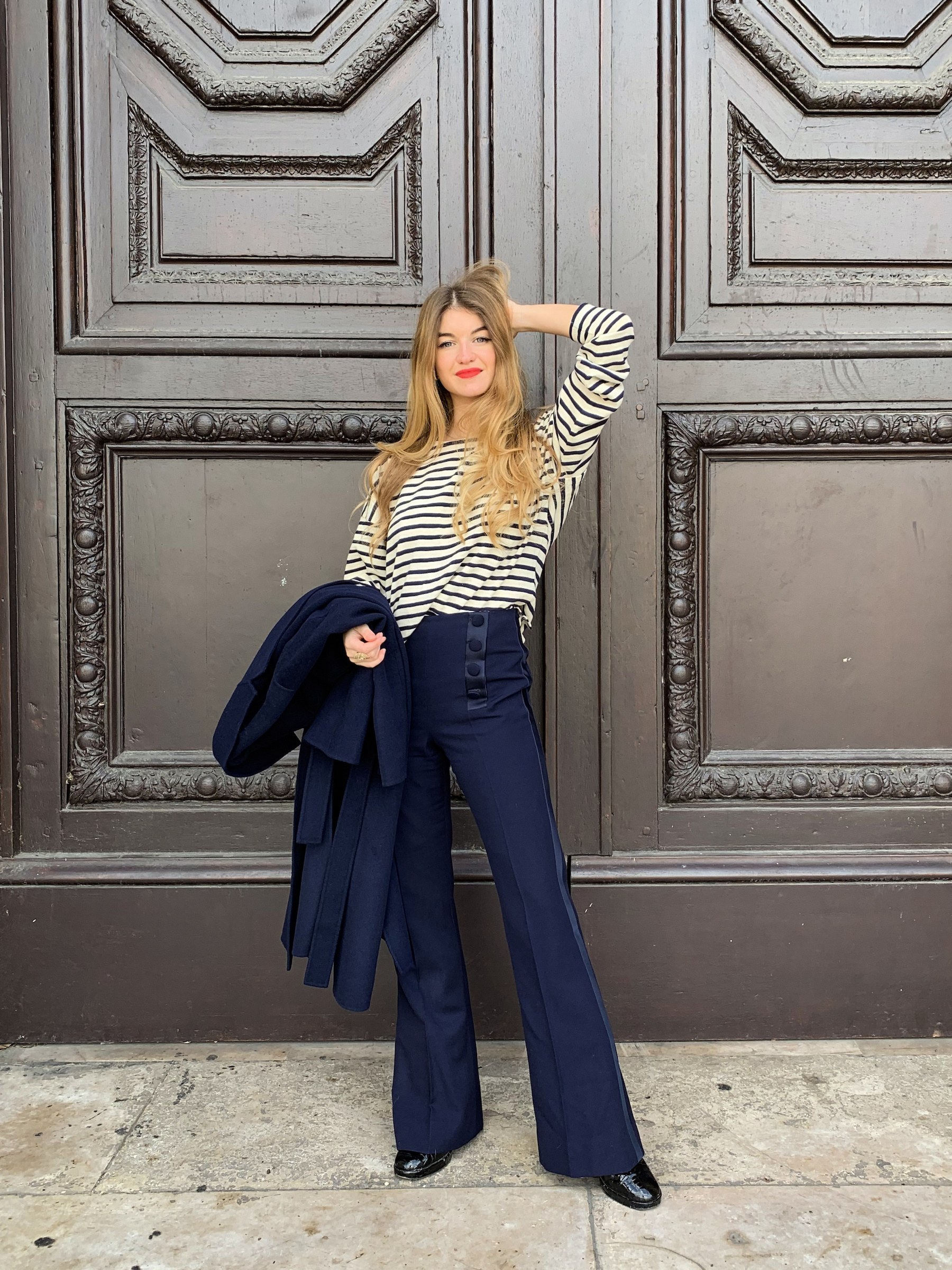 Constance Arnoult wearing high waisted navy pants in Paris