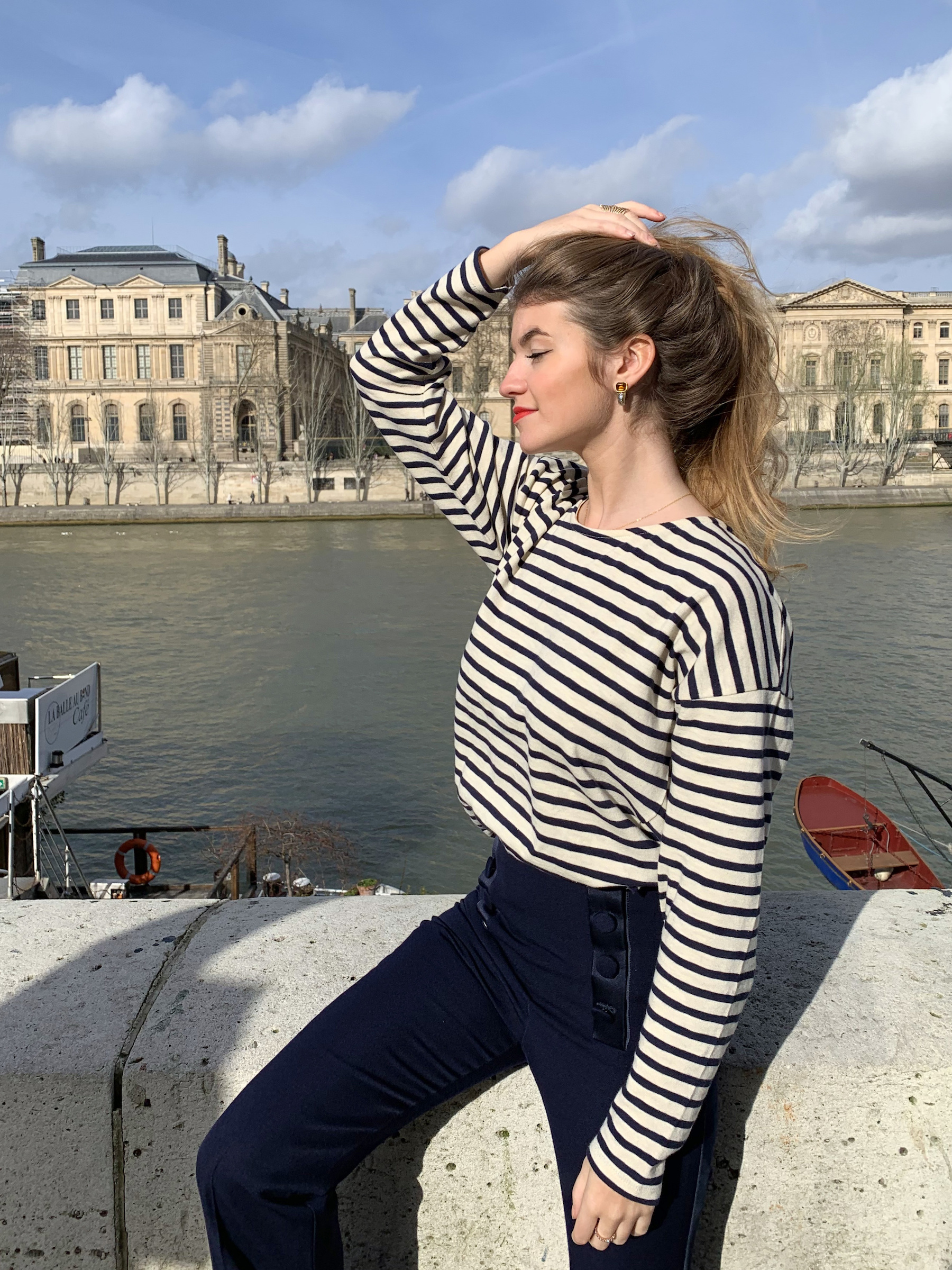 Constance Arnoult wearing a marinière top on the banks of the Seine River